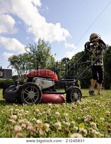Young Boy Cutting Grass