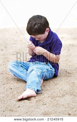Cute Little Boy Playing Alone