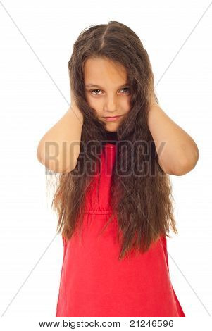 Unhappy Girl Covering Ears