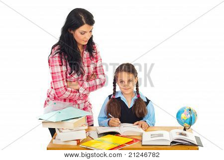 Teacher With Schoolgirl In Classroom