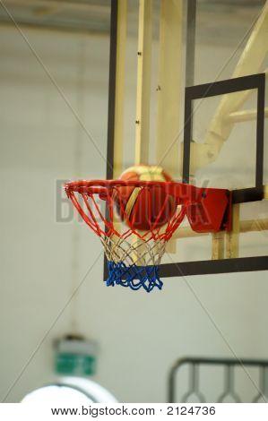 Basketball Swishing Through The Hoop