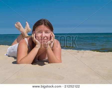 Woman relaxing by sea shore