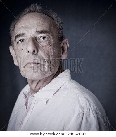 Winner pose of an old man (senior)