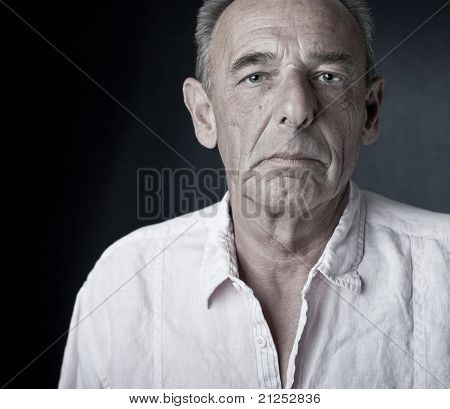 Arrogant looking man (senior)