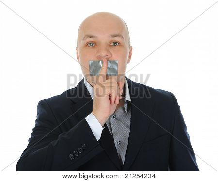 young businessman holding a finger to his mouth.