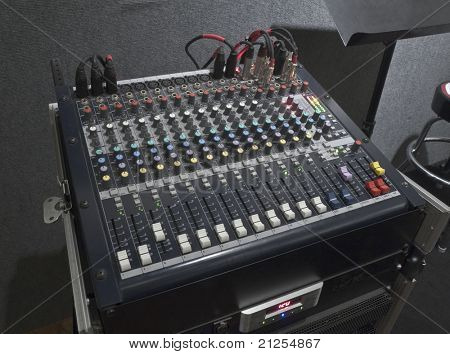 Little music mixing board sitting on it's road case.