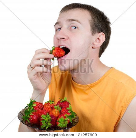 Young The Man Eats A Strawberry