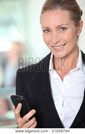 Smiling businesswoman with an office background