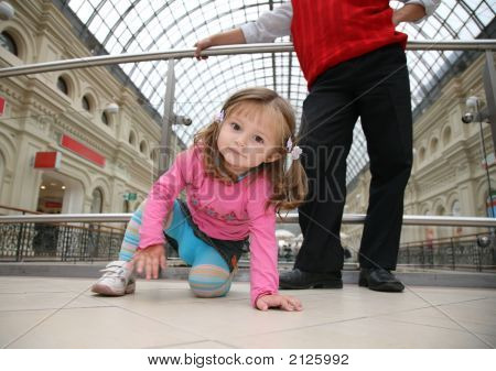 Child With Father In Shop