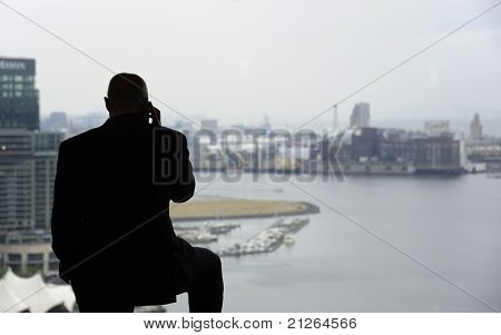 Bald Man In Window On The Phone