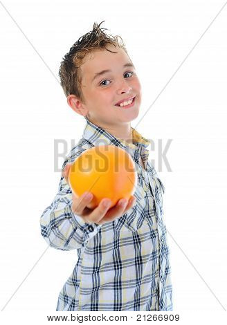 Little kid holding fresh oranges.
