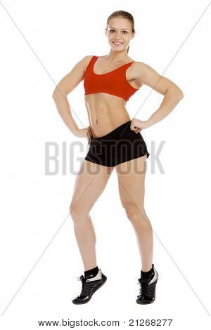 Smiling young sporty muscular woman. Isolated over white background.