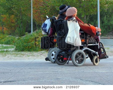 Old Women On Wheelchairs