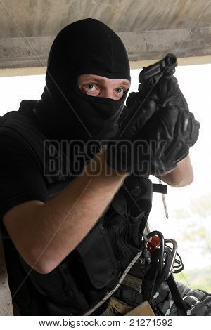 Soldier In Black Mask With 9Mm Pistol