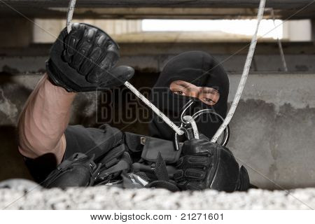 Soldier In Black Mask Dealing With Rope