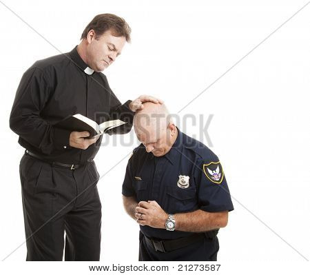 Police officer gets a blessing from his priest.  Isolated on white with room for text.