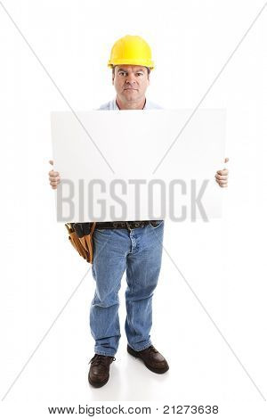 Construction worker with serious expression,  holding a blank white sign.  Isolated on white, full body.