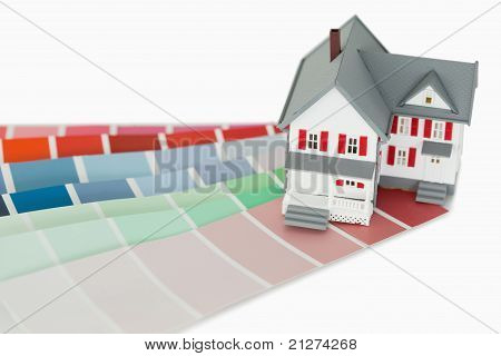 A Maniature House And A Color Chart
