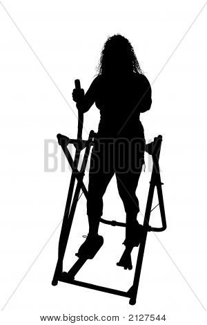Silhouette With Clipping Path Of Woman On Exercise Machine