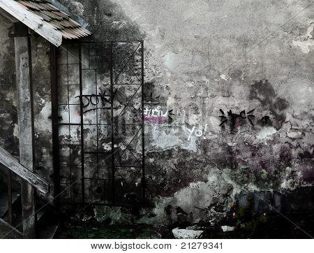 Devastated gray wall with graffiti