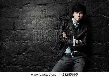 Closeup Portrait Of The Beautiful Young Man In A Leather Jacket