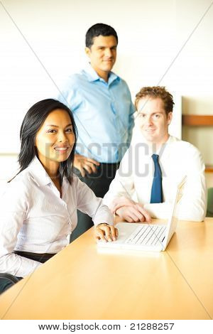 Diverse Team Meeting With Laptop