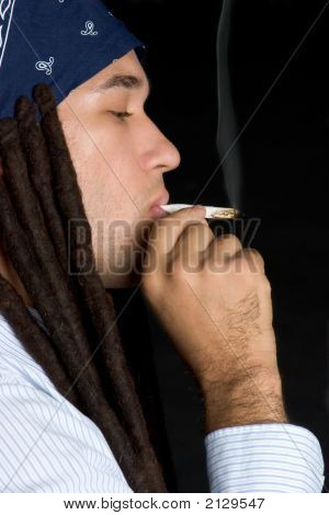 Man Smoking A Joint
