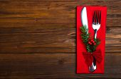 Christmas Table: Knife And Fork, Napkin And Christmas Tree Branch On A Wooden Table Top View With Co poster