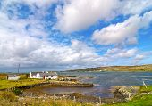 Beautiful Old Irish Cottage By The Sea. Cottage Set In A Scenic Rural Irish Countryside. poster
