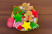 Plate With Tasty Christmas Cookies On Wooden Table poster
