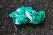 Rough Dioptase Crystal Of Gemstone On Dark poster