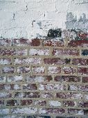 stock photo of arsenic  - Brick Wall With Some White Paint and Some Red Brick - JPG