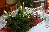 Beautiful Floral Centerpiece With Candles On A Festive Dining Table Laid Ready For Christmas Dinner poster
