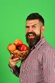 Farmer With Cheerful Face Holds Red Apples poster
