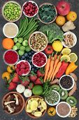 Large health food collection with fruit, fish, vegetables with spices and herbs also used in natural poster