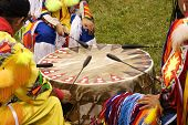 foto of native american ethnicity  - Indian men and boy beating drum at Indian Pow Wow - JPG