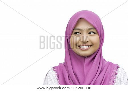 portrait of beautiful young Muslim Woman looking to the copyspace