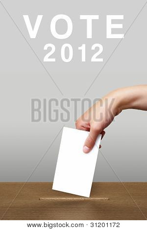 Hand putting a voting ballot in a slot of wooden box on white background, Vote 2012