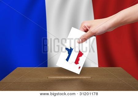 Hand with ballot and wooden box on Flag of France