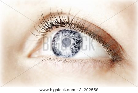 Beautiful abstract blue eye, female face part, healthy vision, extreme closeup