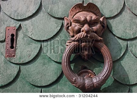 Vintage Rusty Door Knocker In Pisa Italy