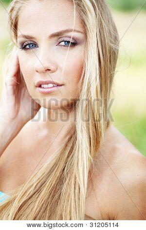 Young beautfiul woman walking outdoors at summer