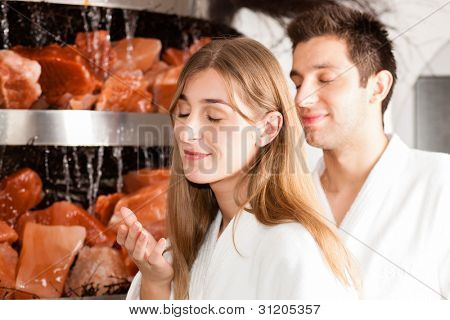 Young couple inhaling essential oil in salt cave of a Spa