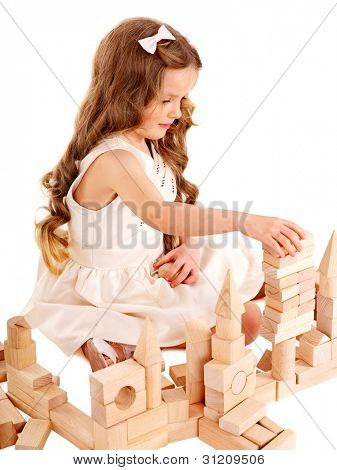 Happy child playing building blocks. Isolated.