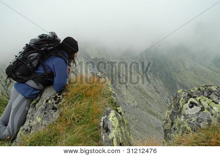 Girl on the top of the mountain. View from the Negoiu peak, Fagaras mountains, Romania