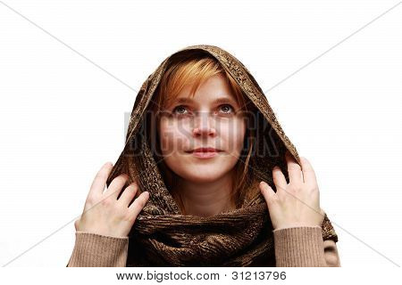 A Woman In A Shawl Looks Up
