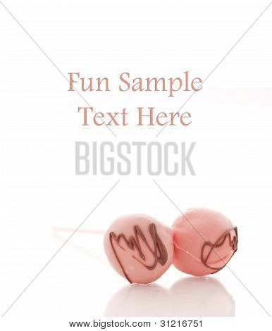 Two Strawberry With Chocolate Drizzle Cake Pops And Space For Text