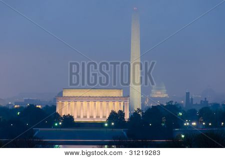 Washington DC city view during an early foggy sunrise, including Lincoln Memorial, Monument and Capitol building