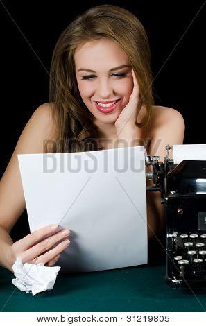 The beautiful girl at a typewriter. Retro
