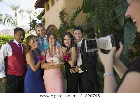 Group of Friends Being Videotaped at Prom